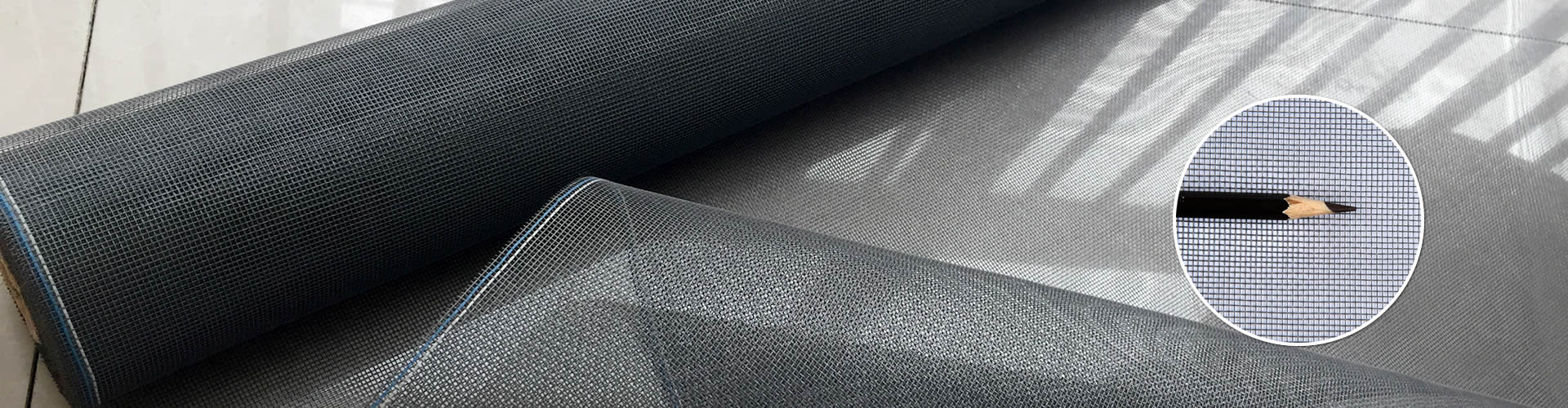 This is a roll of black anti-dust window screen with fine mesh structure and high density.