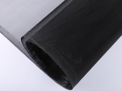 The picture shows a roll of aluminum alloy insect screen with black finish.