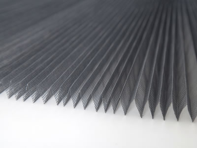This is a piece of pleated insect screen in gray.