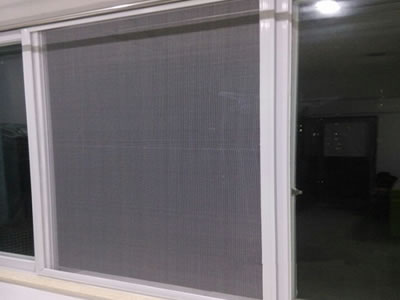 Nylon insect screen is used on a sliding window which has the white frame.
