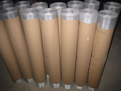 Aluminum alloy insect screens are packed in rolls and covered by brown paper.