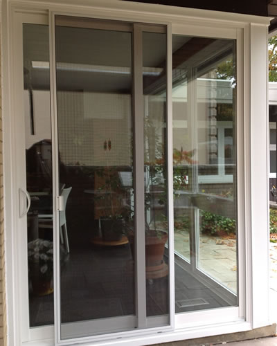 There is a sliding patio door in residential area, which is used sliding insect screen.