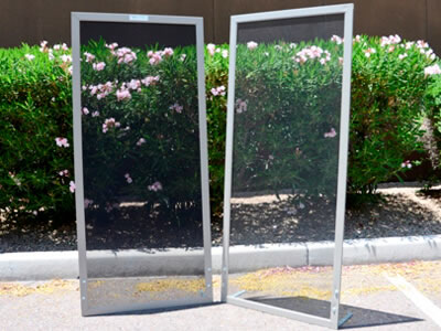 In front of the flowers shrubs, there are two samples of the anti-pollen screen.