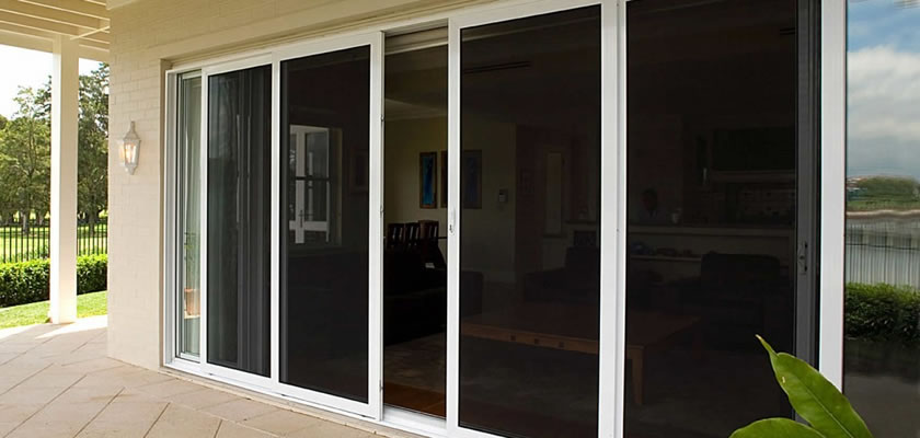 There is a sliding door of a villa installed the diamond mesh screen for security.